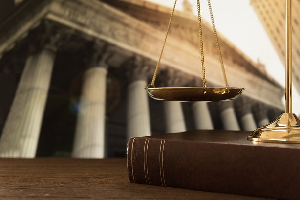 Coleman Macdonald Scales Of Justice On Law Books